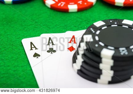 A Man Shows His Three Aces During A Game Of Poker, Gambling, Risk.