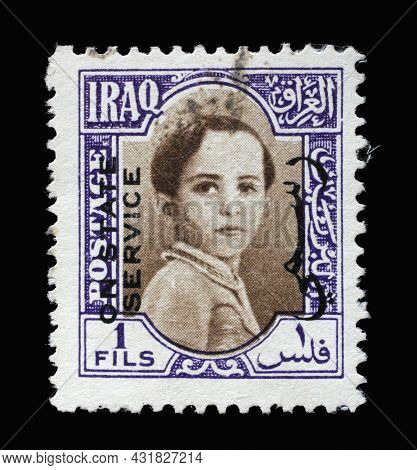 ZAGREB, CROATIA - SEPTEMBER 18, 2014: Stamp printed in Iraq shows portrait of King Faisal II (1935-1958), King Faisal II as a child series, circa 1942