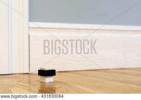 Modern Door Stop On The Floor. The Door Stopper. Modern Door Stop On The Floor. The Door Stopper.