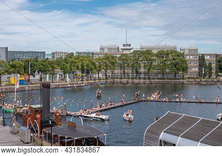 Amsterdam, Netherlands - August 15, 2021: Open Water Public Swimming Dock At Marineterrein Adjacent