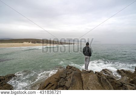 Traveling Man Thinking On Some Rocks On The Coast Of Northern Spain Contemplating The Tranquility An