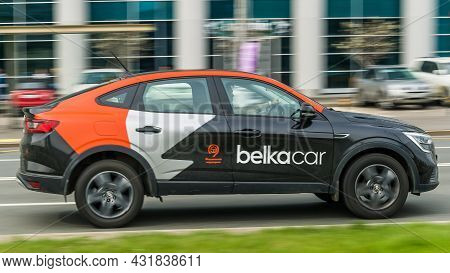 Car Renault Arcana Of The Belka Car Hire Company Is Moving Fast Along A City Street. Rental Car Shar