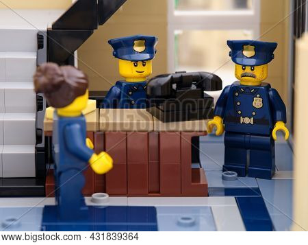 Tambov, Russian Federation - August 02, 2021 Three Lego Police Officers Near Old Telephone In A Poli