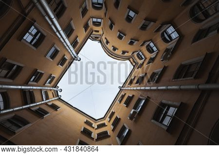 St. Petersburg, Russia - October 25, 2014: Dark Inner Courtyard Of An Old Yellow Living House In Sai