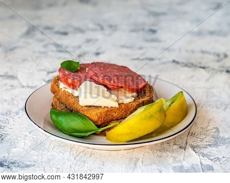 Sandwiches With Smoked Sausage And Curd Cheese On Toasted Bread, Tomato Wedges