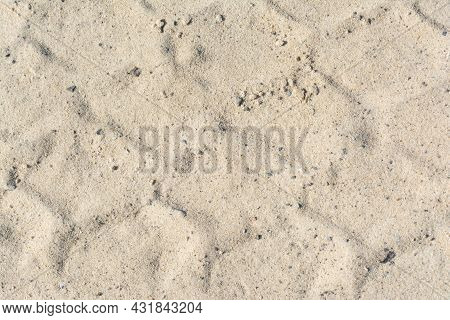 Traces In The Sand From The Car Wheel Protectors.