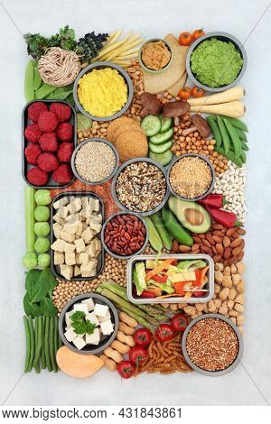 Large low carb vegan diet food for healthy ethical eating, plant based health foods to lower cholesterol, blood pressure. Eco friendly, sustainable, go green, plant based, save the planet concept.