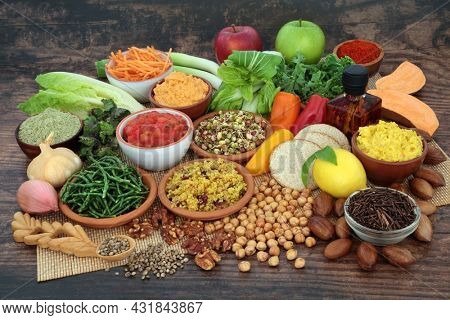Vegan food for healthy lifestyle concept. Health foods high in protein, omega 3, vitamins, minerals, antioxidants, anthocyanins, fibre. Eco friendly, sustainable agriculture, mindful eating.