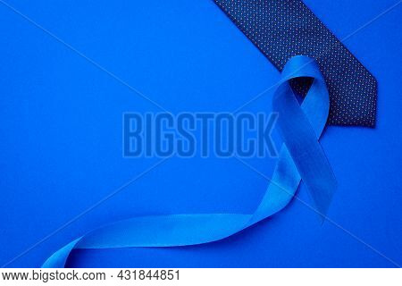 Prostate Awareness. Blue Ribbon, Fashion Tie Isolated On Deep Blue Background. Awareness Prostate Ca