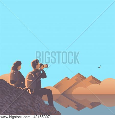 Man And Woman With A Camera Are Sitting On The Lake.