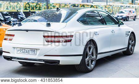 Rear Side View Of White Genesis G80 Car Second Generation Rg3 . Premium Electrified Korean Sedan On