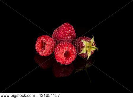 Raspberry Isolated. Raspberries With Leaf Isolate. Raspberry With Leaf Isolated On Black Background.