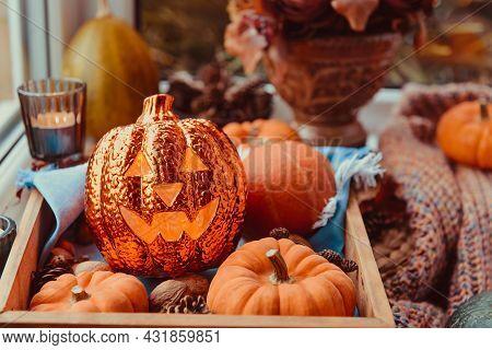 Close Up Halloween Cozy Mood Composition On The Windowsill. Lighting Jack-o-lantern, Decorative Pump