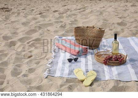 Bag, Blanket, Wine And Other Stuff For Beach Picnic On Sand
