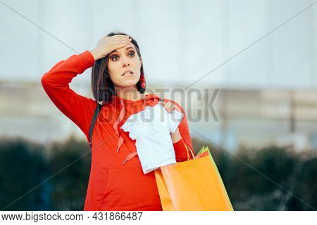 New Mom Holding Baby Clothes Forgetting To Buy Something