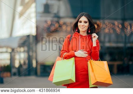 Pregnant Woman Touching Baby Bump Holding Shopping Bags