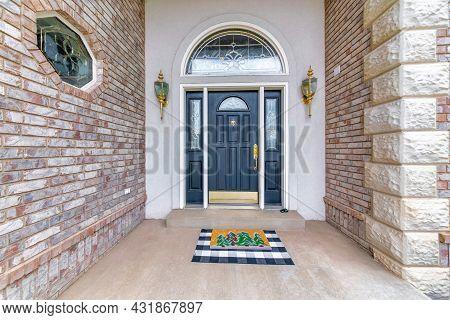 Stunning Front Door Exterior Of A House With Golden Fixtures