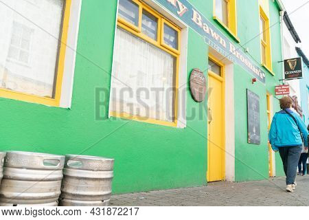 Dingle Ireland - August 12 2017; Bright Green And Yellow Frontage Of Tourist Attraction Distillery A