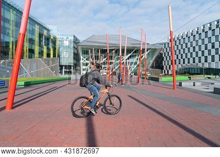 Dublin, Ireland - August 10 2017; ; Commuters Cycle And Walk Through Grand Canal Square Surrounded B