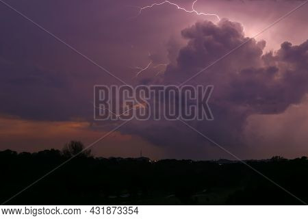 Lightning Strikes During Thunderstorms.  The Concentrated Power Of Nature Illuminates The Night Sky.