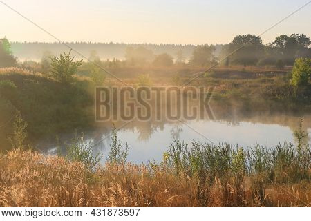 landscape with small lake in steppe with morning light
