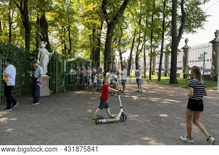 St. Petersburg, Russia - July 09, 2021: People On Vacation In The Summer Garden In St. Petersburg