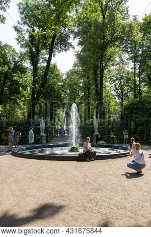 St. Petersburg, Russia - July 09, 2021: People On Alley With A Fountain In The Summer Garden In St.