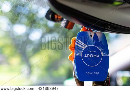 Miercurea Ciuc, Romania-  04 September 2021: Hanging Aroma New Car Air Freshener On Car Interior.