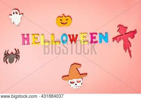 Holiday Helloween On A  Pink Background With A White Leaf, Pumpkin, Ghost, Scarecrow, Skull, Witch