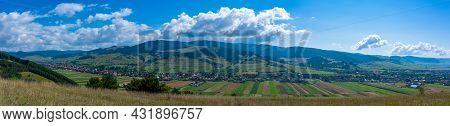 Panoramic View Of A Hungarian Village Called Csikszentgyorgy In Hungarian, Ciucsangeorgiu In Romania