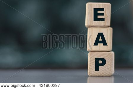 Eap (employee Assistance Program) - Acronym On Wooden Cubes On A Blurr Gray Background. Internet Con