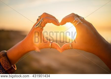 Bohemian Chic Gypsy Woman Wearing Hands Jewelry Accessories And Dress Showing Love Sign. Boho Detail