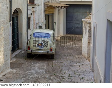 Locorotondo, Italy - August 8, 2021: Traditional Vintage Italian Car Fiat 500 Parked In The Old Town