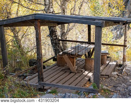 Wooden Gazebo With A Table And Chairs For Relaxing In The Altai Mountains. Che-chkysh, Altai Republi