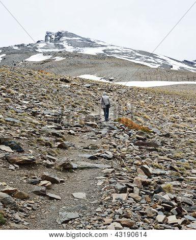 Hiker Climbing To The Peak Veleta In The Sierra Nevada