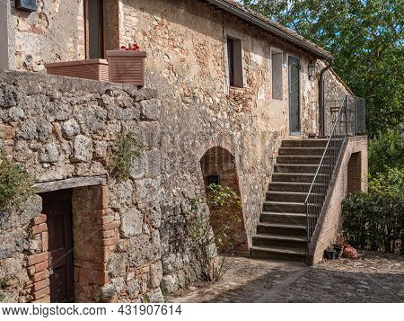 Ancient Farmhouse And Rural Dwelling With Outdoor Stairs In The Medieval Village Of  Monteriggioni,