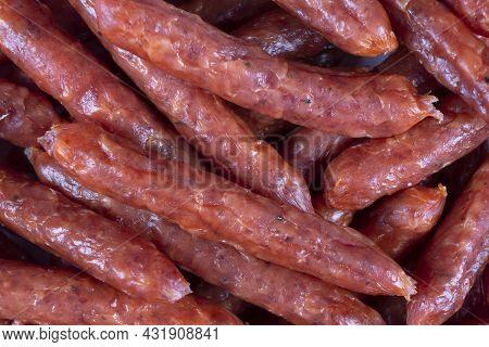 Top View Macro Shot Of Smoked Pork Salami Chorizo Sausages Background Texture. Raw Smoked Salami Sau