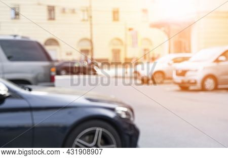 Blurred Background With Cars On The Strret. Bokeh Lights Background. Abstract Blur Car Parking Lot F