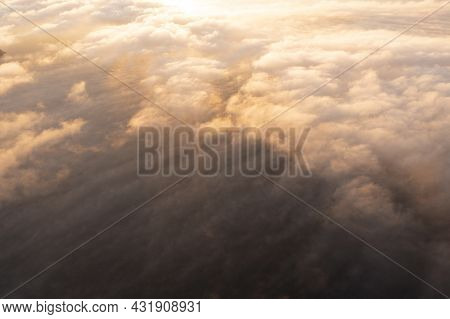 Aerial Top View Gold Sunrise Over Clouds In Blue Sky. Aerial Top View Cloudscape. Texture Of Clouds.