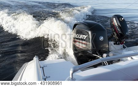 Sankt-petersburg, Russia, August 27, 2021: Modern New Fishing Sport Boat With A Brand New Mercury Fo