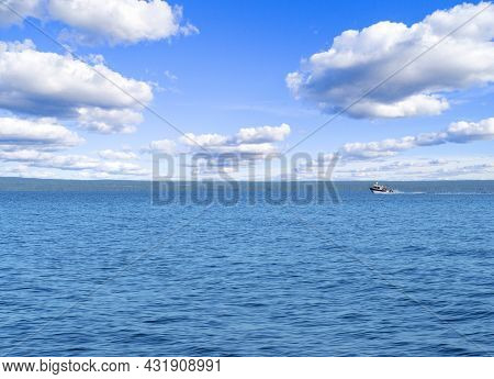 Speeding Fishing Motor Boat With Drops Of Water. Blue Ocean Sea Water Wave Reflections With Fast Fis