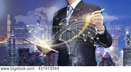 Businessman In City Point On Arrow Graph. Business Man Use Ipad Tablet Draw High Rate Chart On World