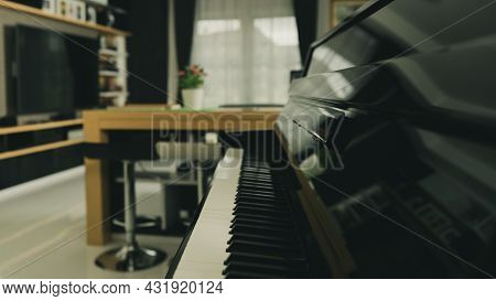 Piano Keyboard With Blur Background Home Living Room With Modern Interior Decoration.