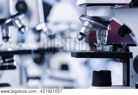 Close Up Shot Of Microscope Lens And Colorful Blur Background Copy Spae.