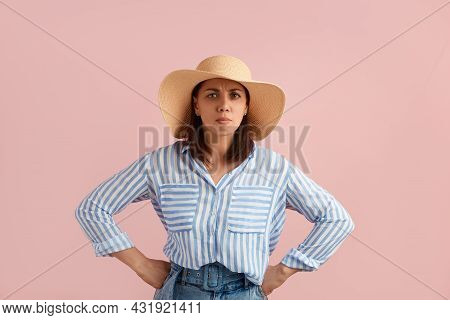 Serious Frowning Woman Brunette Keeps Hands On Waist, Stands Akimbo, Suspects Something Misleading,