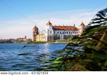 Mir, Belarus - October, 18, 2019. Europa. Medieval Castle In Mir, Belarus. View Across The Lake To T