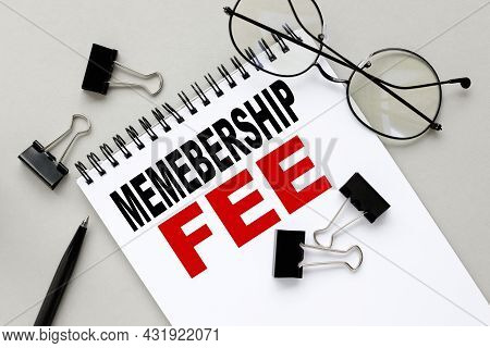 Membership Fee, Notepad On Gray Background Near Black Stationery Clips And Glasses