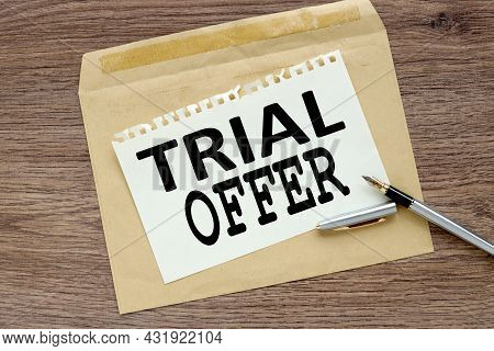 Trial Offer. Craft Notebook On Wood Table With Text On Paper And Pen