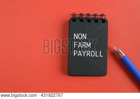 Pen And Notebook Written With Text Non Farm Payroll