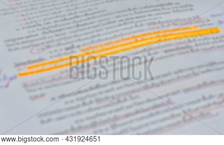 Blurred Document With Written Note And Highlighting Text. Closeup Shot For Background